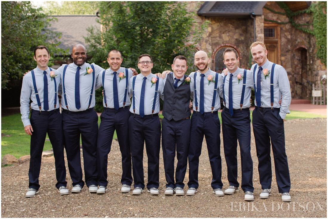 casual groomsmen attire with navy pant, tie, and suspenders