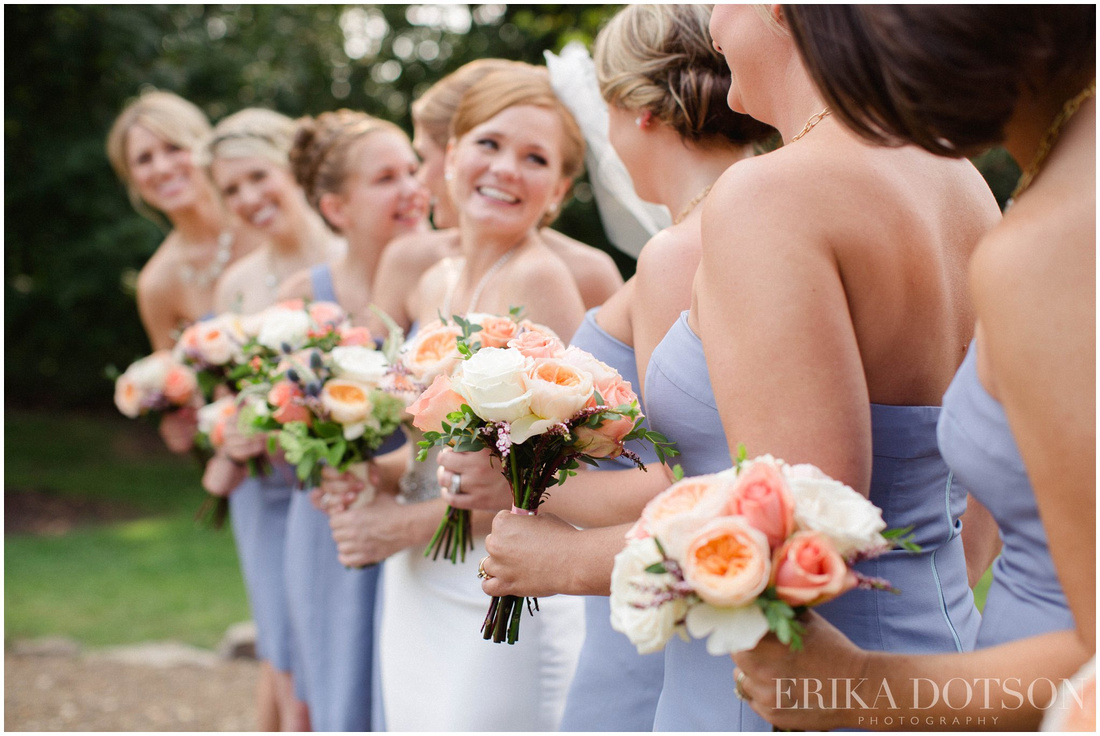 blue bridesmaid dresses with an array of lovely pink and coral wedding bouquets