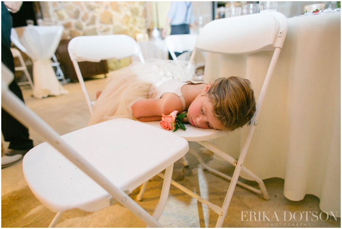 Real moment captured of flower girl asleep during reception